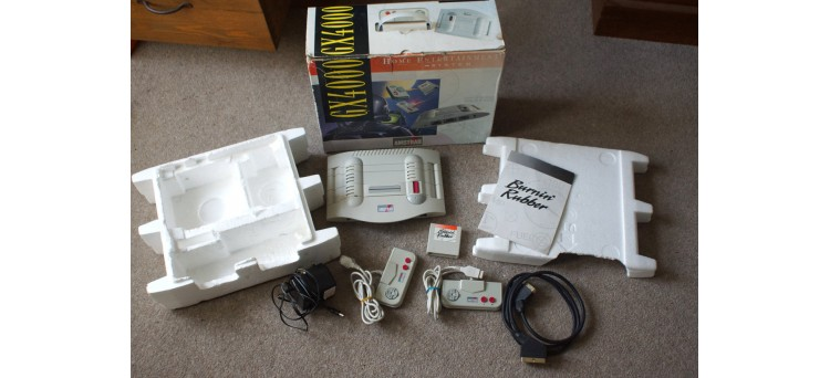 GX4000 Amstrad Games Console with Gamepads/controllers, Burnin' Rubber Game, Power Supply, Scart & Box